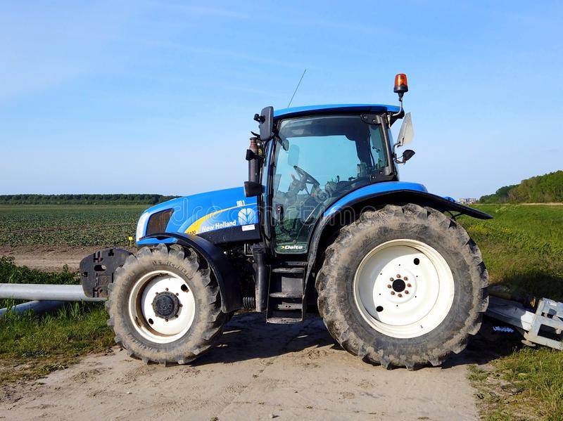 Blue New Holland tractor. Almere, Flevoland, the Netherlands - May 14, 2019: Blue New Holland tractor royalty free stock photography