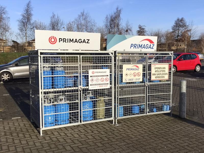 Closed Primagaz point of sale stand. Almere, the Netherlands - Januari 18, 2019: Closed Primagaz point of sale stand with blue Campingaz cylinders royalty free stock photos