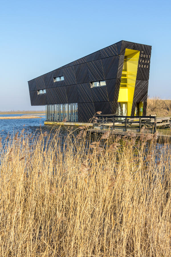 ALMERE, NETHERLANDS - MARCH 17, 2016: NP Oostvaardersplassen. Visitor center Oostvaarders in NP Oostvaardersplassen, a large wild reserve with wetland and large royalty free stock photo