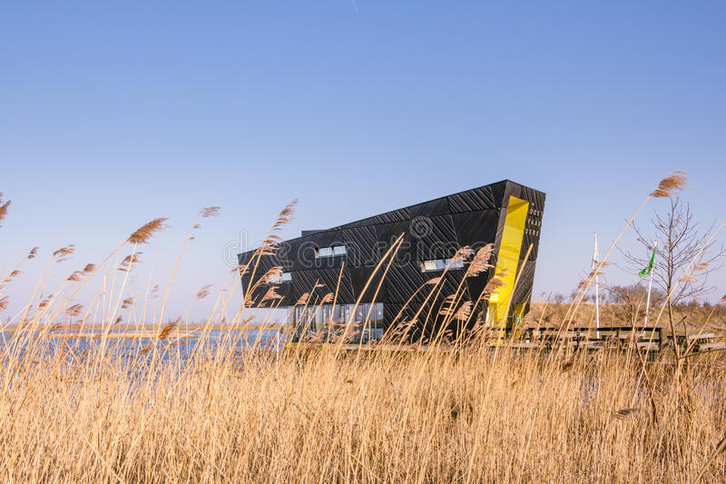 ALMERE, NETHERLANDS - MARCH 17, 2016: NP Oostvaardersplassen. Visitor center Oostvaarders in NP Oostvaardersplassen, a large wild reserve with wetland and large stock photography