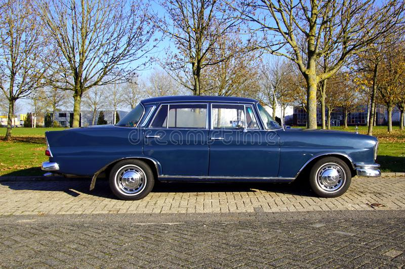 Blue Mercedes-Benz 220. Almere, The Netherlands - November 17, 2018: Mercedes-Benz 220 parked on a public parking lot. Nobody in the vehicle stock image