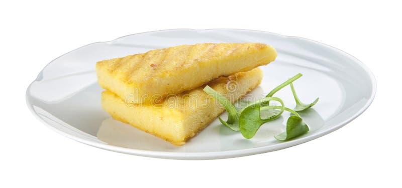 Almidón de maíz frito en la placa blanca foto de archivo