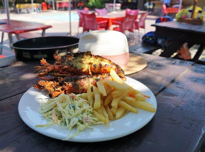 Almoço da lagosta na praia imagens de stock royalty free