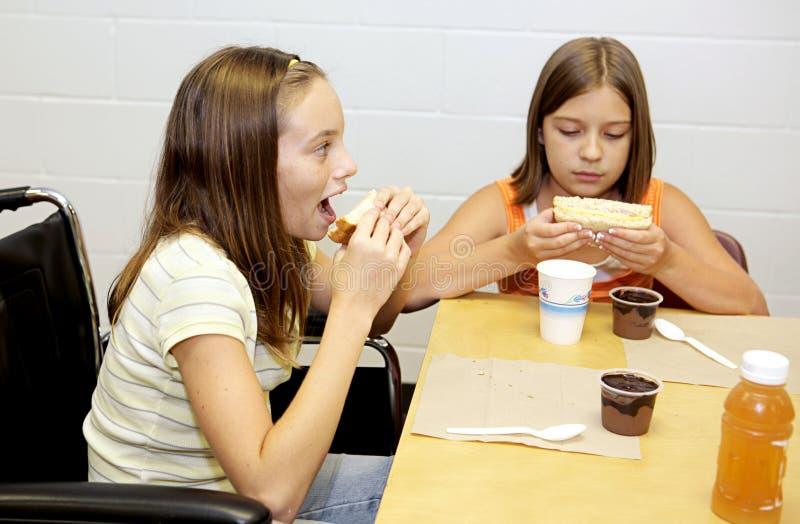 Almoço de escola - tome uma mordida fotos de stock