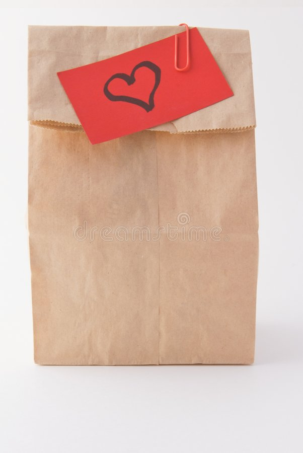 Almoço e amor do saco de Brown fotografia de stock