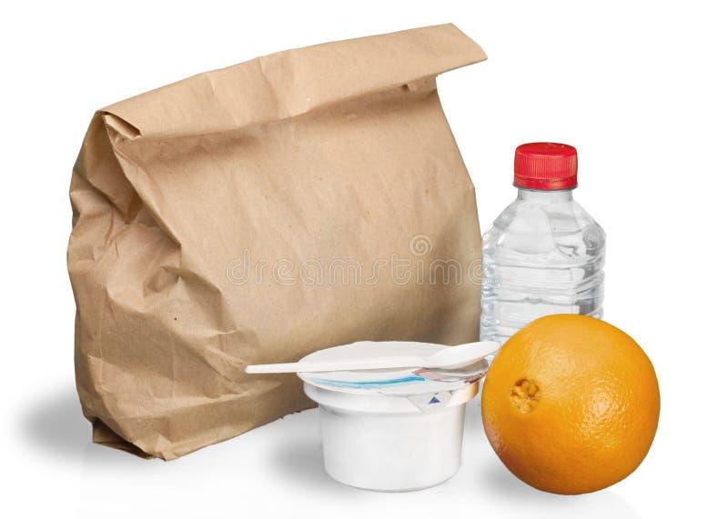 Almoço nutritivo em um saco de Brown - isolado foto de stock