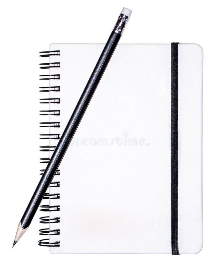Almofada de escrita com um lápis fotografia de stock