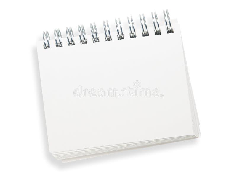 Almofada de memorando espiral em branco isolada no branco. imagem de stock