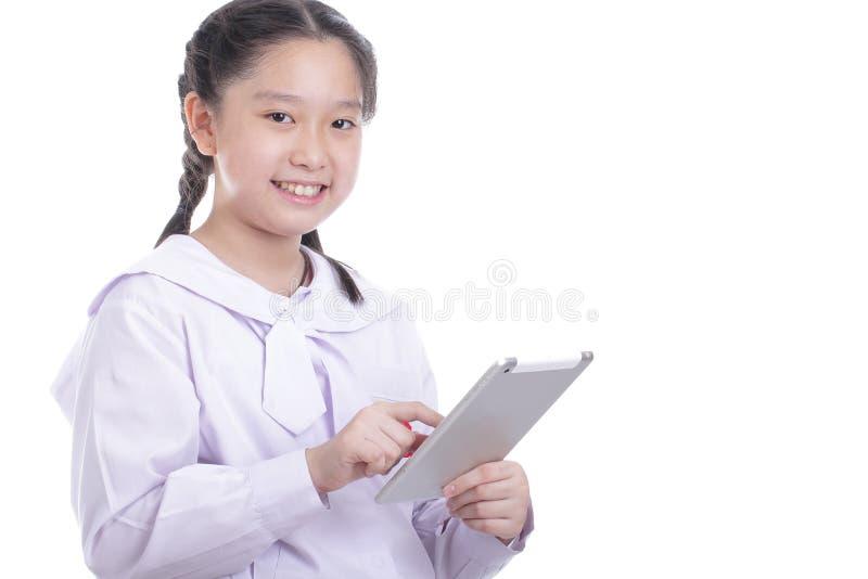Almofada de toque da posse da menina do estudante foto de stock royalty free