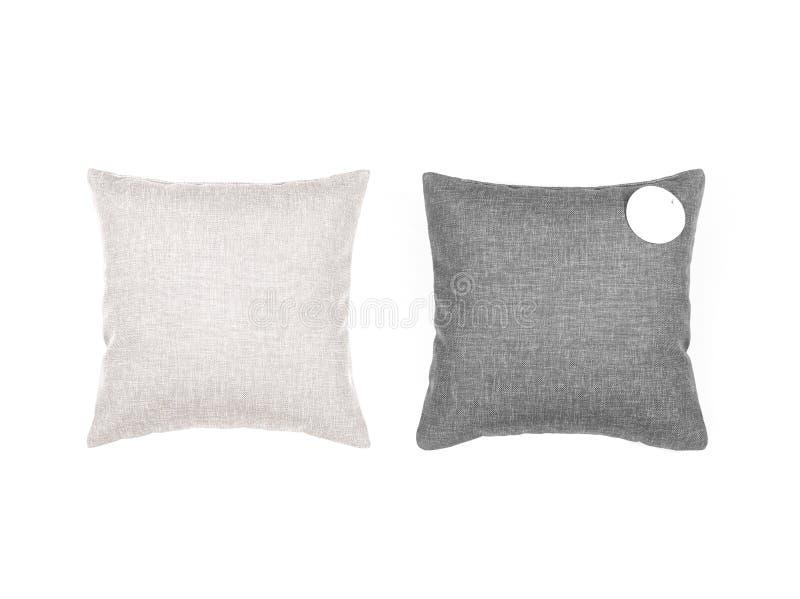 Almohadas grises y beige en el fondo blanco fotos de archivo libres de regalías