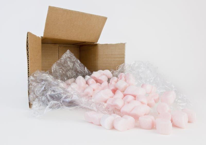 Almohadas y cacahuetes de empaquetado foto de archivo