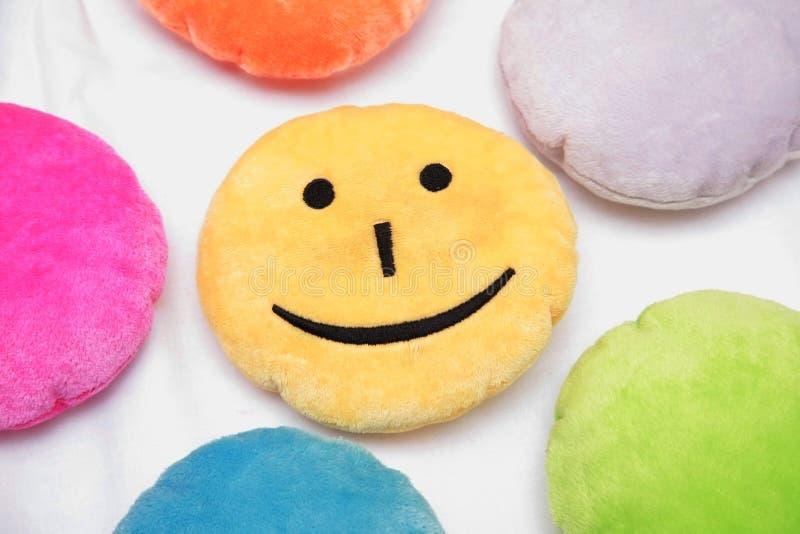 Almohadilla amarilla sonriente fotografía de archivo