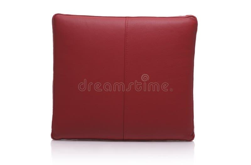 Almohadilla de cuero roja imagenes de archivo