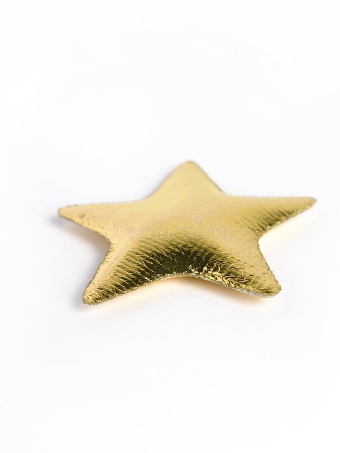 Almohadilla de oro de la estrella fotos de archivo libres de regalías