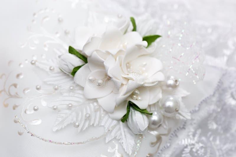 Almohadilla para los anillos de bodas imagen de archivo