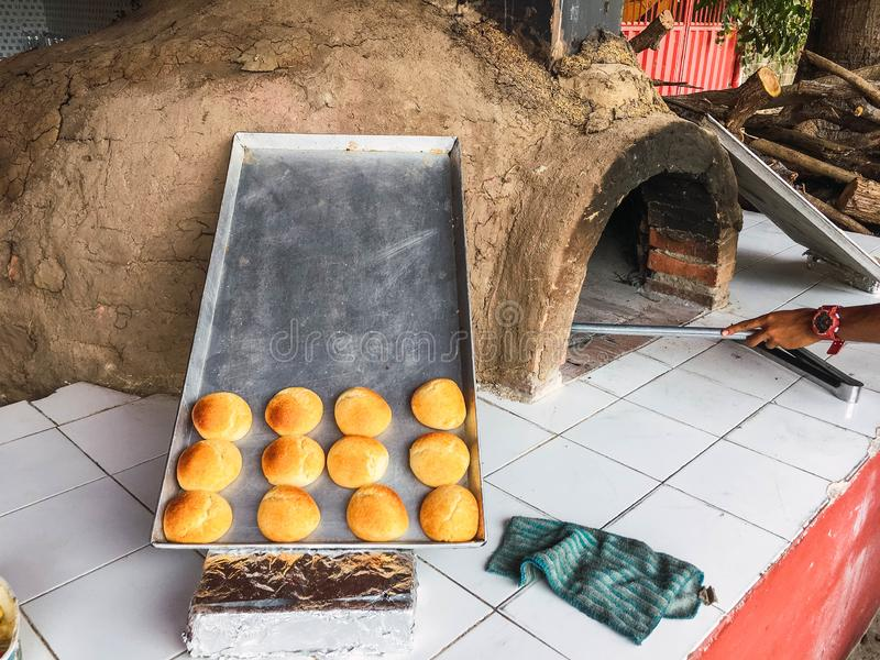 Almojabana, traditional Colombian food - clay oven royalty free stock photography
