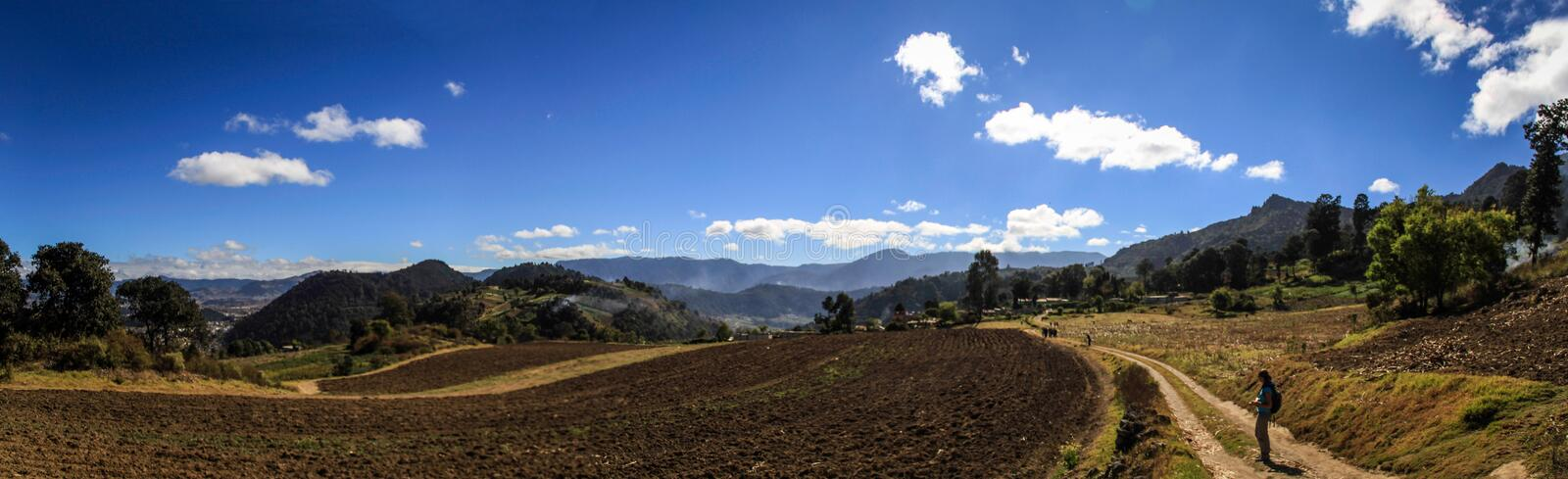 On the way to the cerro Quemado, Panoramic view on the surrounding fields and mountains, Quetzaltenango, Guatemala. The Almolonga volcano, usually called `Cerro royalty free stock image