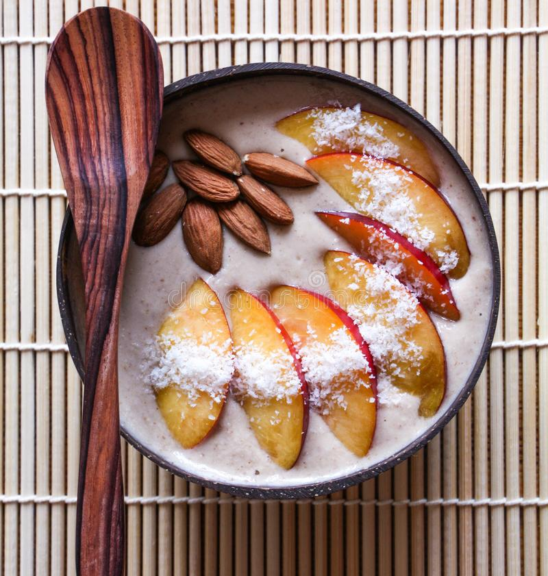 Coconut bowl with fresh fruit and nuts for breakfast royalty free stock photos