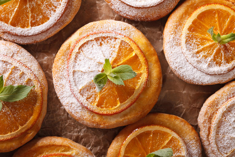 Almond biscuits with orange slices and mint on a table macro. ho. Rizontal view from above royalty free stock photos