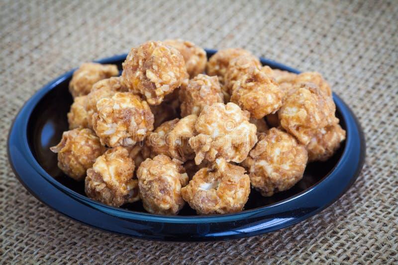 Almond and caramel popcorn stock photo