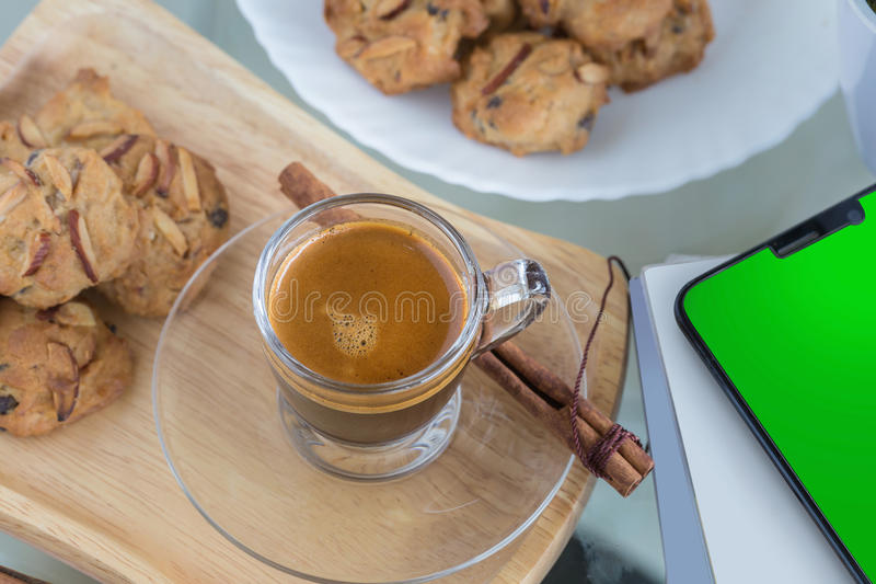 Almond flavored Cookies and Cup of espresso coffee stock photo