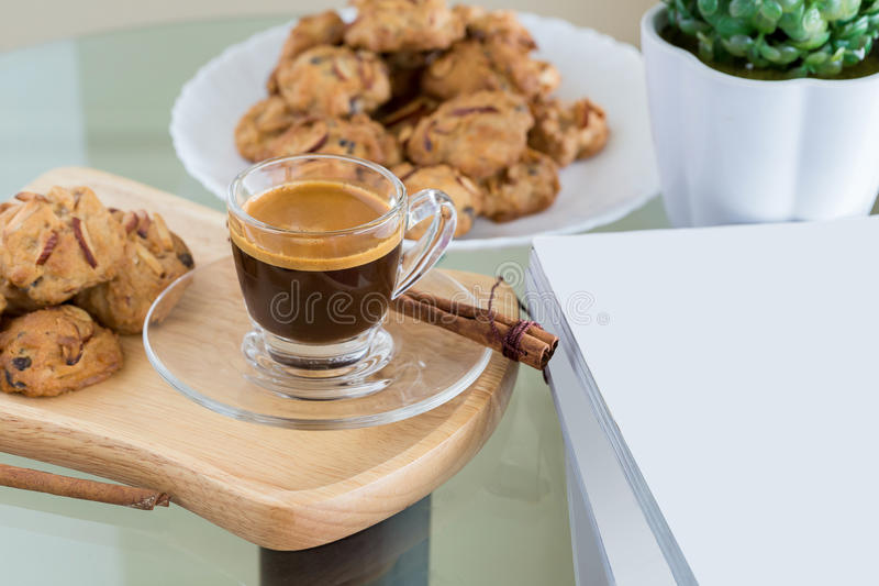 Almond flavored Cookies and Cup of espresso coffee stock photos