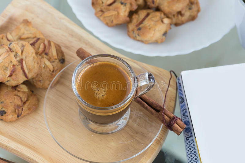 Almond flavored Cookies and Cup of espresso coffee stock images