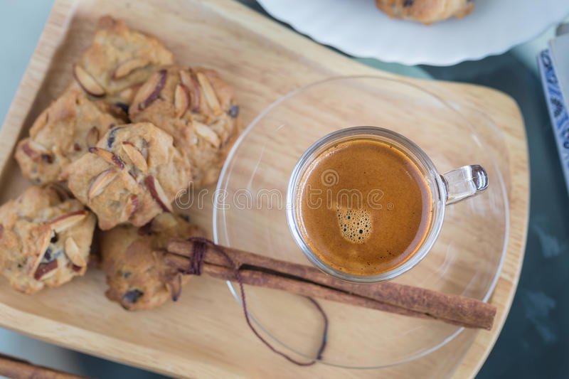 Almond flavored Cookies and Cup of espresso coffee royalty free stock photography