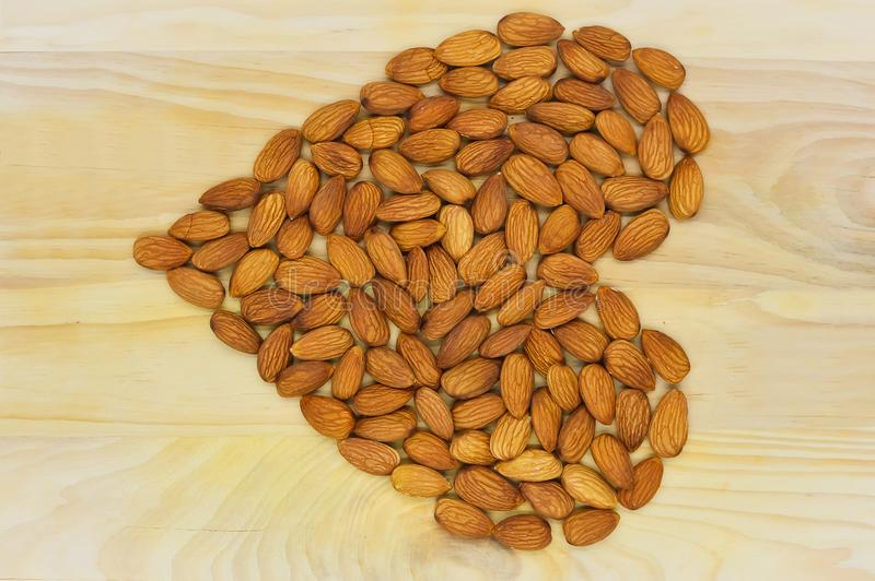 Almond heart on the wood royalty free stock images