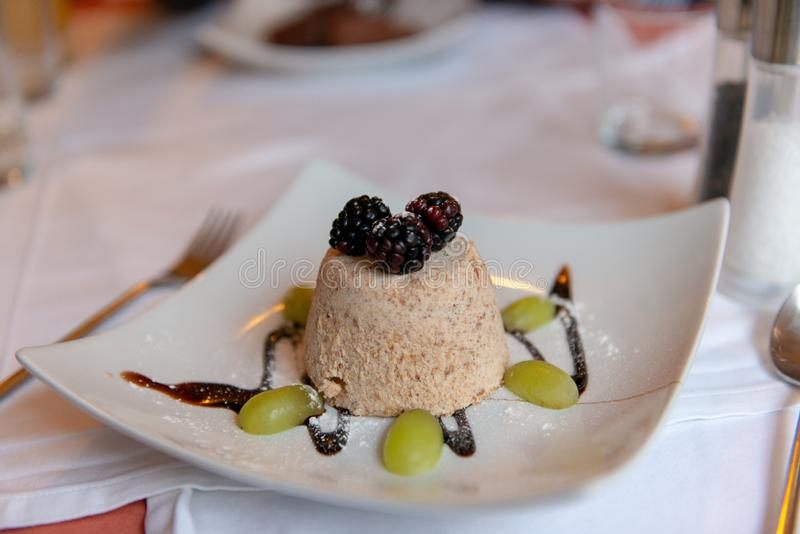 Almond ice cream with berries and grapes stock images
