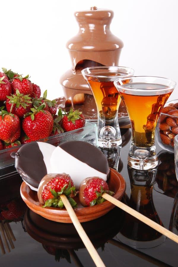Almond liquor and fondue fountain royalty free stock photos
