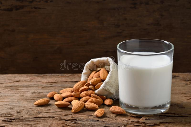 Almond Milk with seeds. In hemp fabric bag on old wood background royalty free stock image