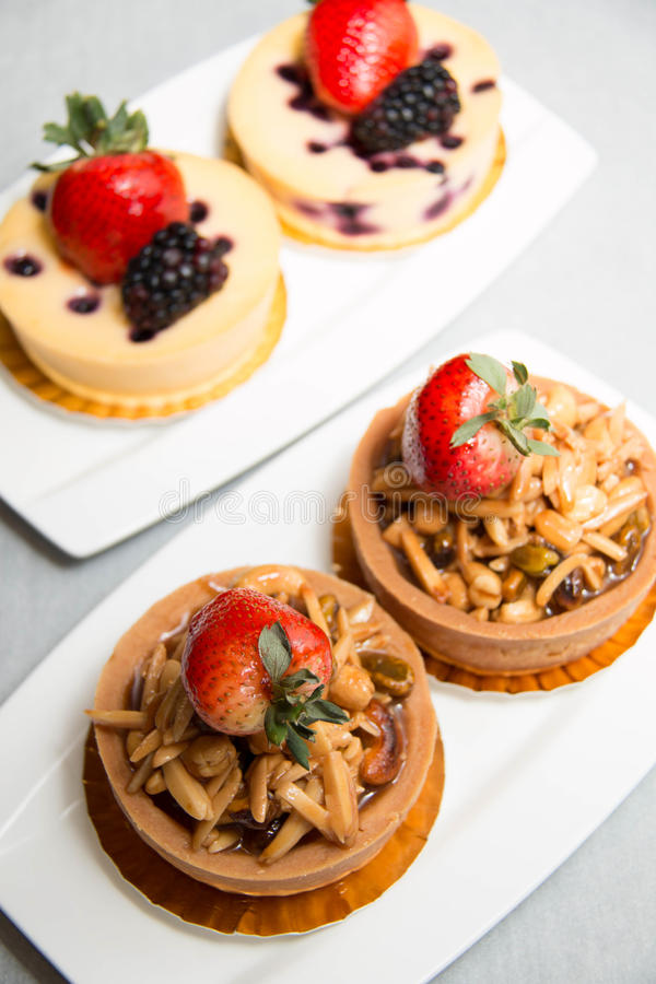 Almond nut tart on top fresh strawberry and blueberry cheese royalty free stock images
