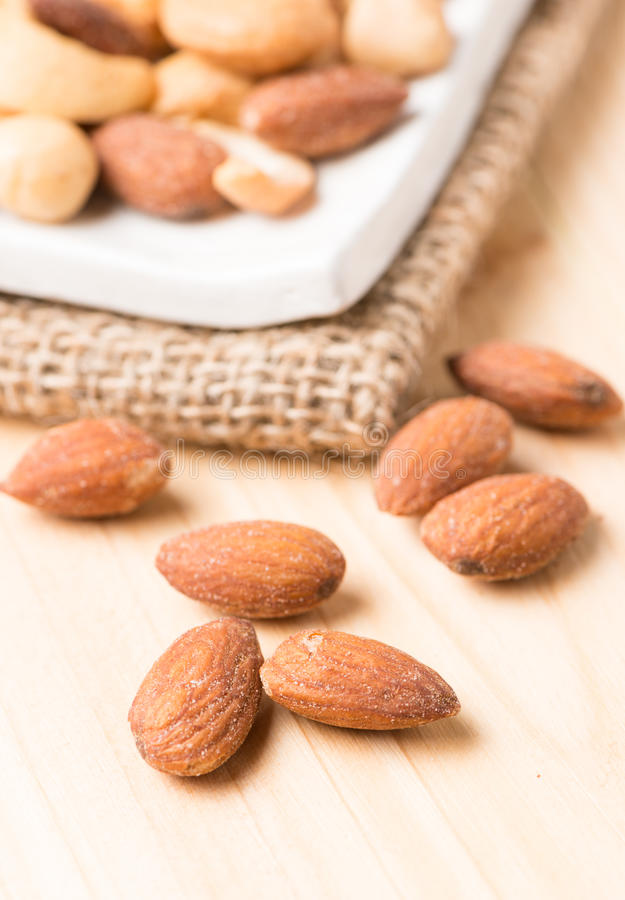 Almond nut on wood background royalty free stock image