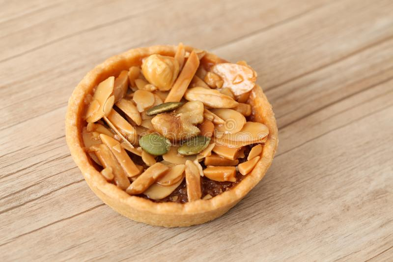 almond nuts pistachio walnut hazelnuts tart cake  on table royalty free stock photos