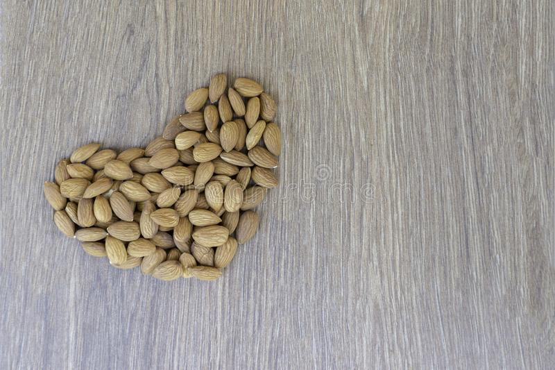 Almond nuts shape of a heart stock images