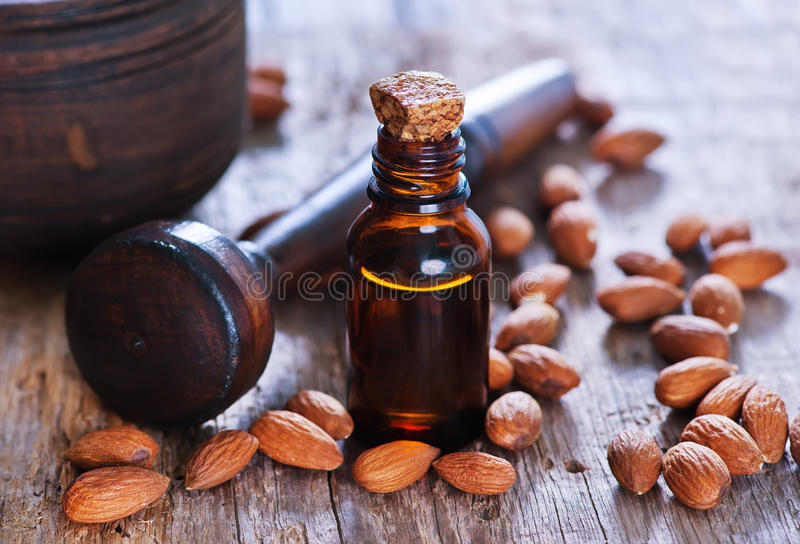 Almond oil in a glass bottle royalty free stock images