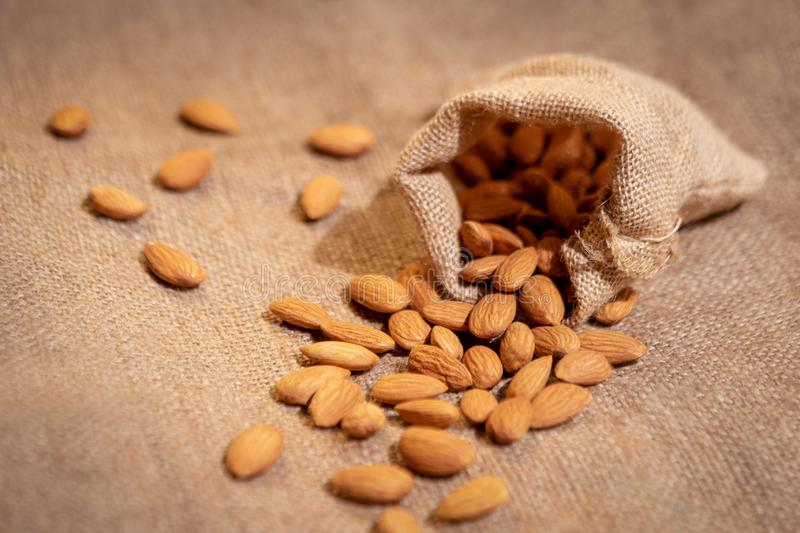 Almond Pouring Out From Sack stock images