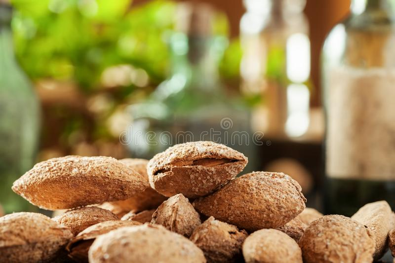 Almond in shell macro shot with kitchen stuff in the background.  royalty free stock photos