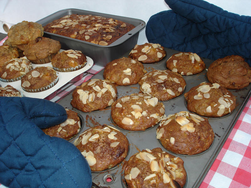 Almond topped muffins. Big batch baking to stock the freezer and eat warm stock images