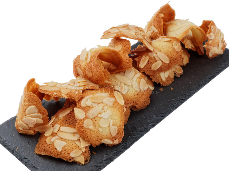 Almond tuiles. Pastry house presented on a slate royalty free stock images