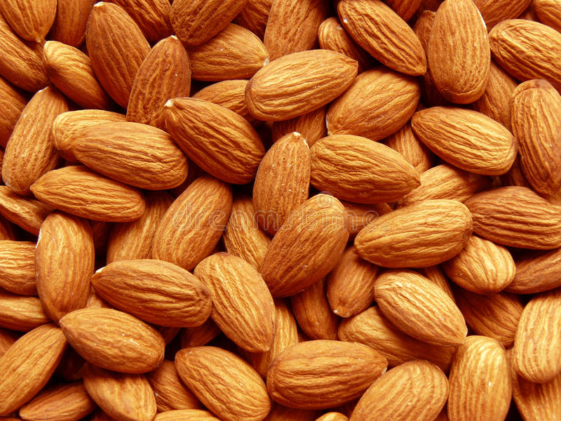 Almond. Whole almond grains food background royalty free stock photography