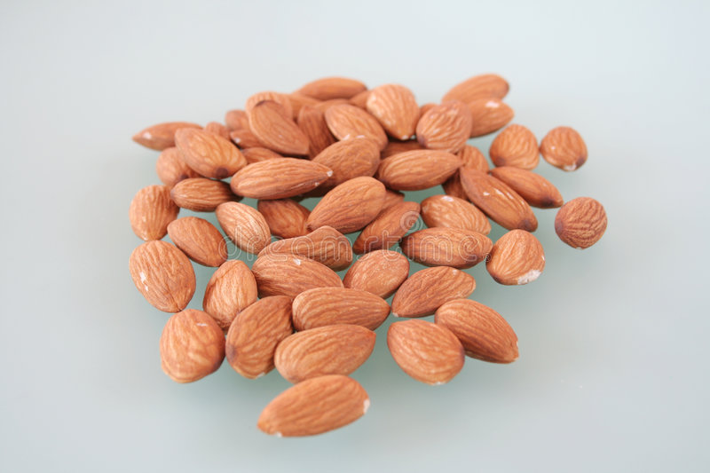 Almonds. Macro picture of roasted almonds royalty free stock photography