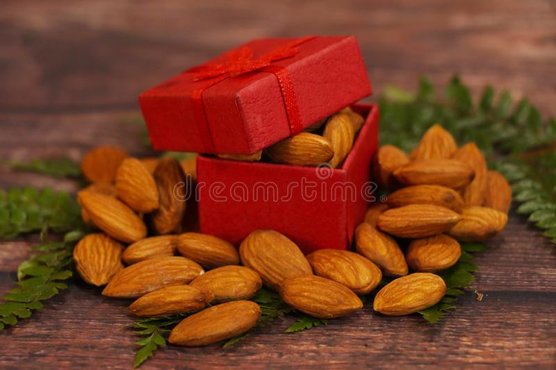 Almonds, almond group, almonds in red gift box. Natural, food. royalty free stock photography