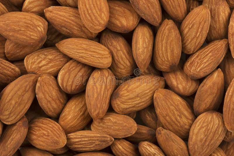 Almonds background. Full frame shot of almonds for sale in market. Copy space for your text royalty free stock image