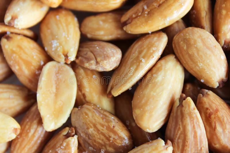 Almonds Background Nuts Seeds Details. Vegetarian Edible Nut Background Whole stock images