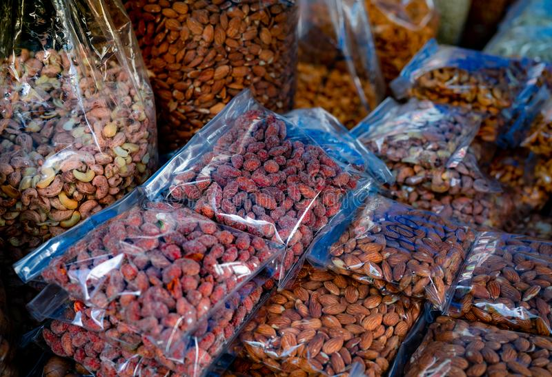 Almonds and cashew nuts in plastic bag at the market. Healthy food. High protein food for fitness or intermittent fasting people. royalty free stock photo