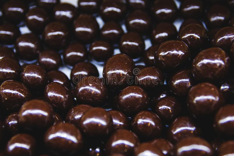 Almonds in chocolate on the shop window close - up view from above stock photo