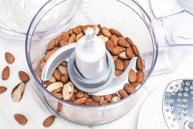 Almonds in a food processor ready to be crushed. For prepare dessert stock photos
