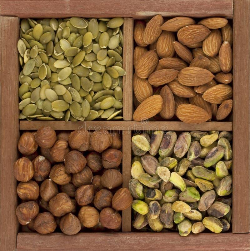 Almonds, hazelnuts, pistachio, pumpkin seed stock images
